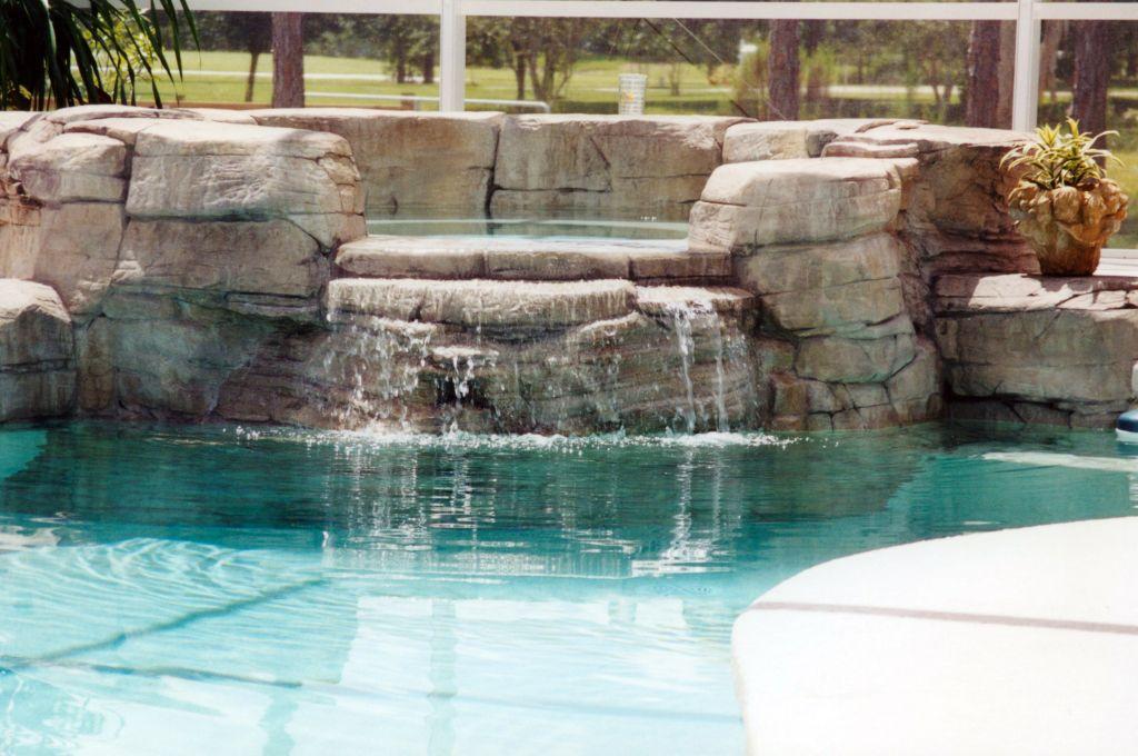 Swimming pool spa rock waterfall